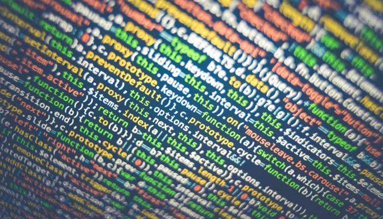 Image description: Close-up of colourful binary code