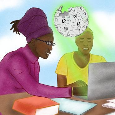 Dos mujeres negras trabajando juntas con una computadora