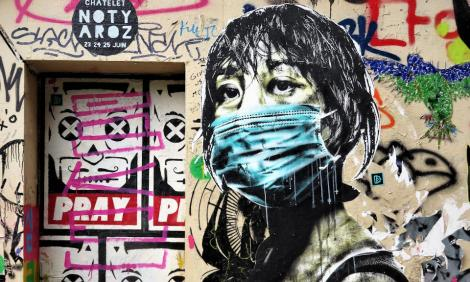 Graffiti of a woman wearing a mask.