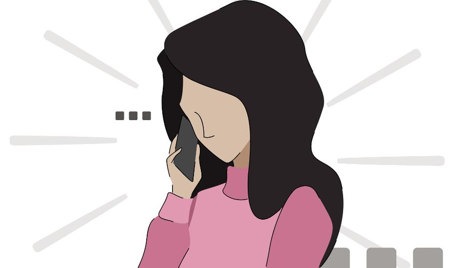woman waiting on the phone