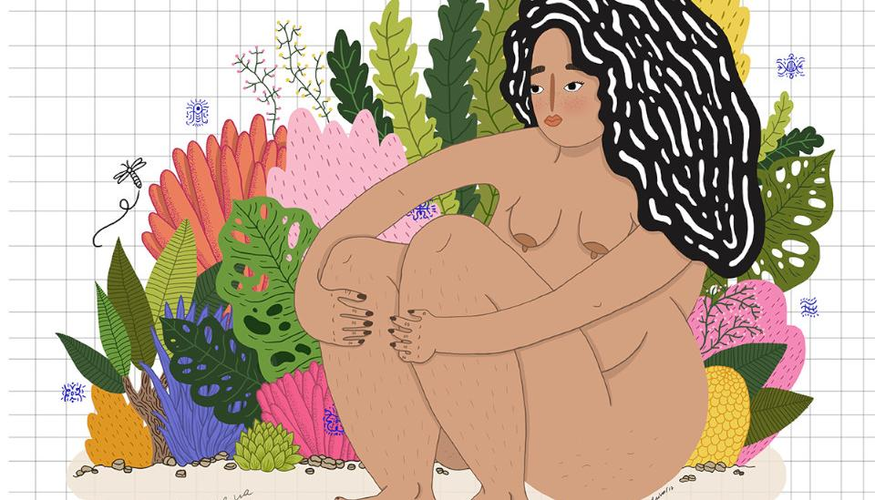 Woman sitting surrounded by plants